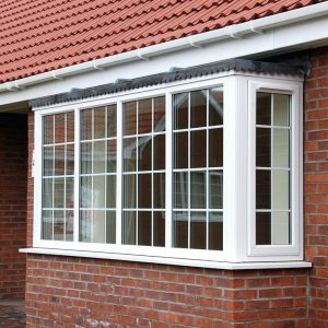 White uPVC bay window with bars bristol