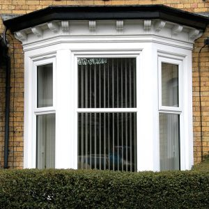 White uPVC casement bow windows
