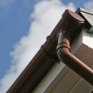 Brown PVCu gutter and white fascia