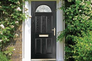 Black composite door with decorative arched glazing