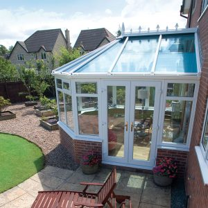 Exterior of a white uPVC glass roof conservatory