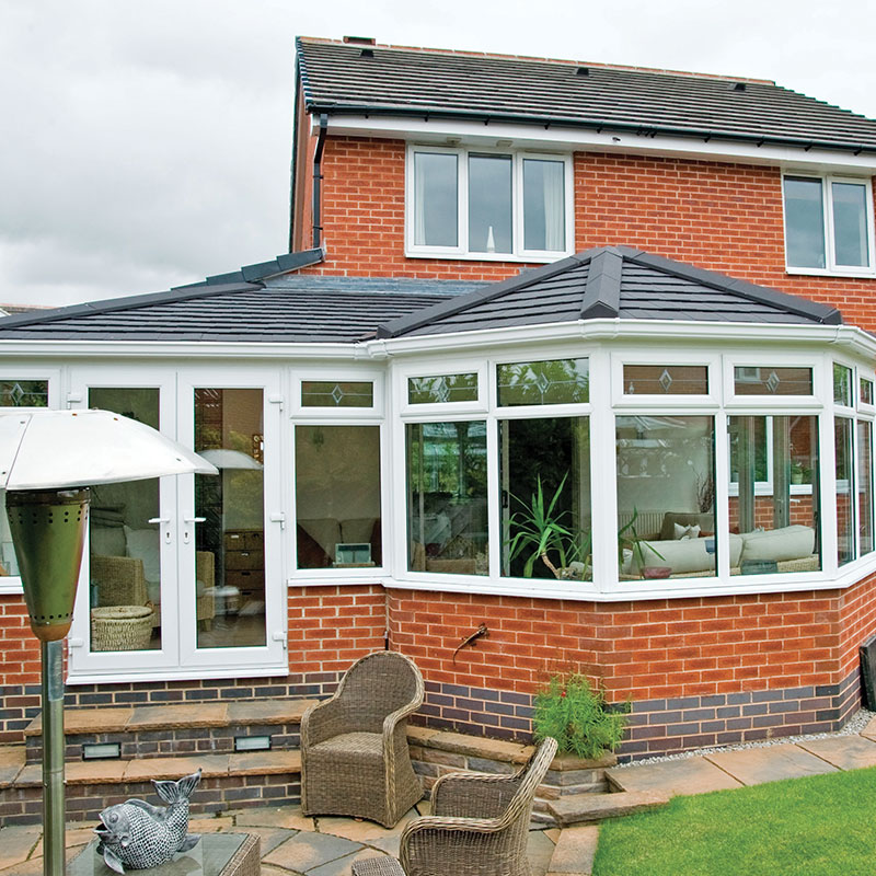 P shaped conservatory with a tiled roof