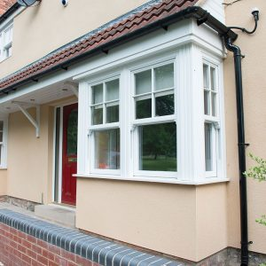 White sliding sash bay windows