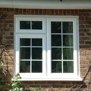 White uPVC leaded casement window