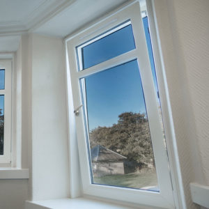 A PVCu tilt and turn window with view onto the garden
